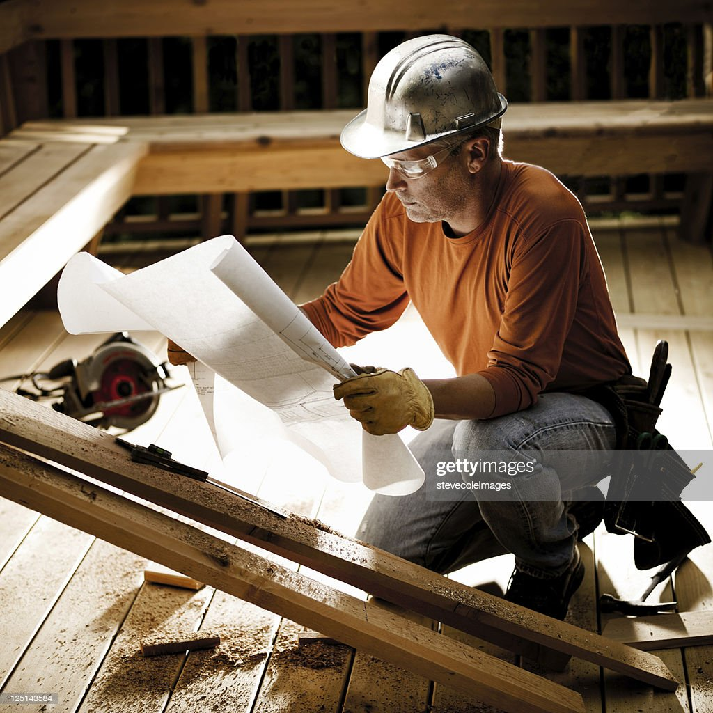 Construction Worker & Blueprints : Stock Photo