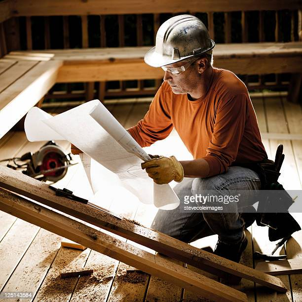 construction worker & blueprints - leather glove stock pictures, royalty-free photos & images