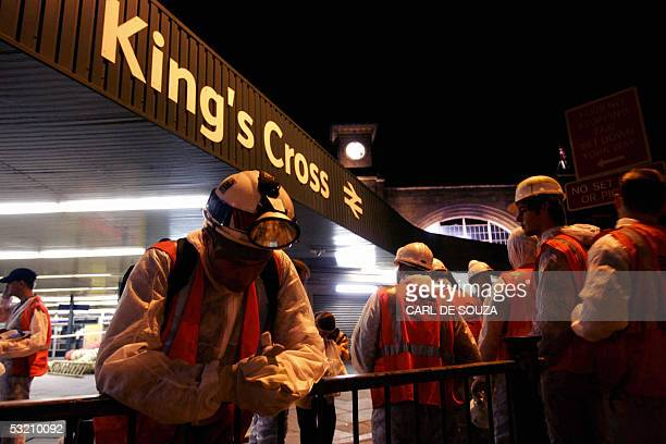 A construction worker bows his head in prayer at Kings Cross station in London where a bomb went off inside the station's tube network resulting in...