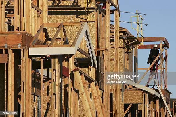 A construction worker builds the framing on a new home under construction January 19 2006 in Dublin California The Commerce Department reported that...