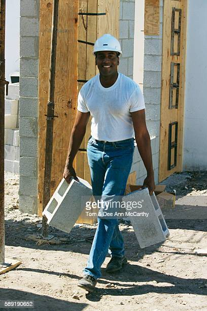 Construction Worker Carrying Blocks