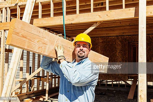 Construction Worker Carrying Wood Beam