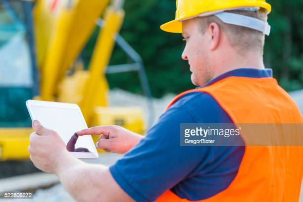Construction Worker Contractor Using Tablet Computer