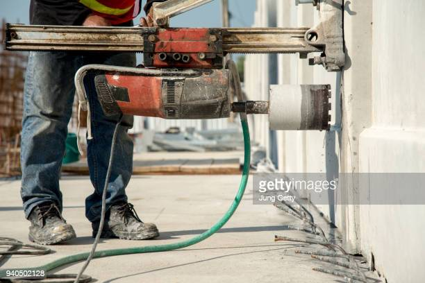construction worker coring concrete - core stock pictures, royalty-free photos & images
