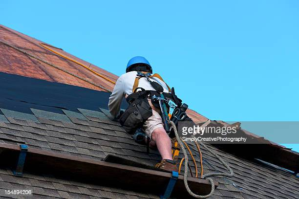 Construction worker doing work on a rooftop