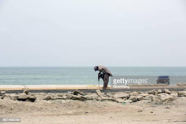 A construction worker drills a hole in a sidewalk on Marine Drive in Gwadar Balochistan Pakistan on Tuesday July 4 2018 What used to be a small...