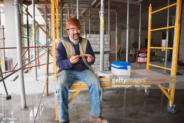 Construction worker eating lunch