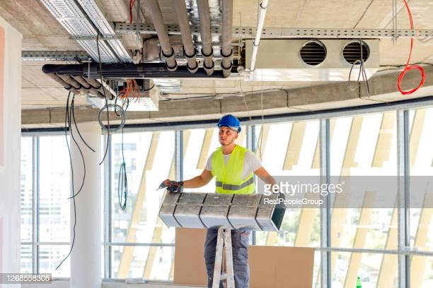 construction worker, engineer or architect on site of building project. inside of construction site. hvac engineering. - installation art stock pictures, royalty-free photos & images
