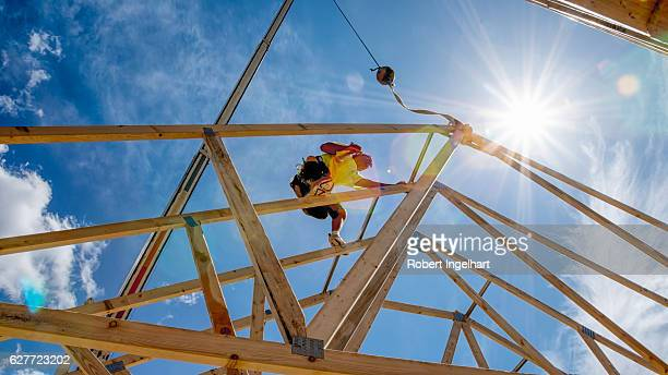 Construction Worker Framing A Building