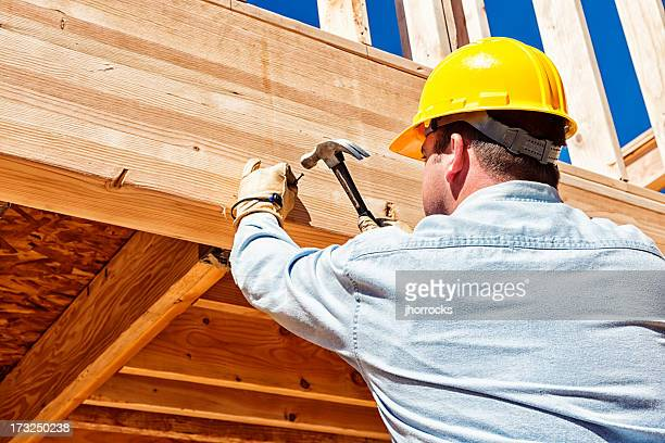 Construction Worker Hammering Nails