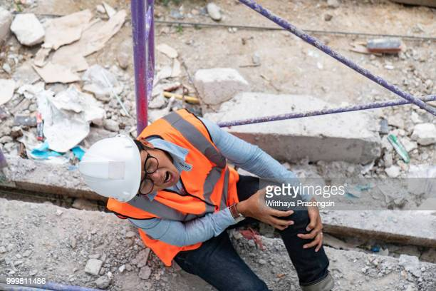 construction worker has an accident while working - casualty stock pictures, royalty-free photos & images