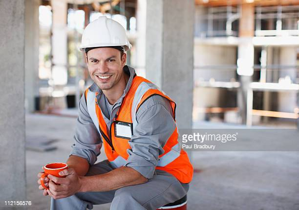 Construction worker having coffee break on construction site