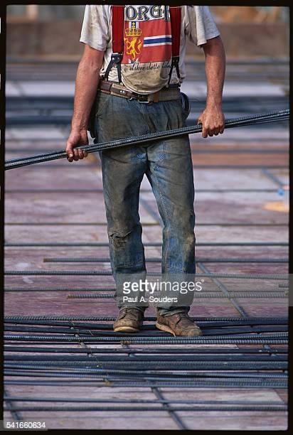 Construction Worker Holding Rebar