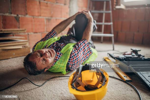 a construction worker injured his knee - misfortune stock pictures, royalty-free photos & images