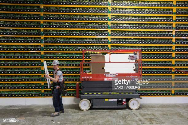 A construction worker inside bitcoin mining at BitFarms in Saint Hyacinthe Quebec on March 19 2018 Bitcoin is a cryptocurrency and worldwide payment...