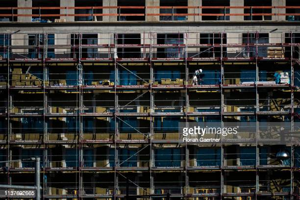 A construction worker is pictured on a scaffold on April 17 2019 in Berlin Germany