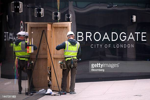 Construction worker is seen at 5 Broadgate, the site for the new UBS AG headquarters, jointly developed by British Land Co. And the Blackstone Group...
