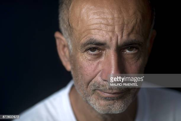 Construction worker Jose Luis Farias da Silva whose son was a victim of stray bullets fired by a police officer poses for a portrait after an...
