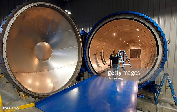 A construction worker makes final adjustments to a large autoclave at Alliant Techsystems Inc's ATK Aerospace Structures ACCW Facility on Friday Sept...