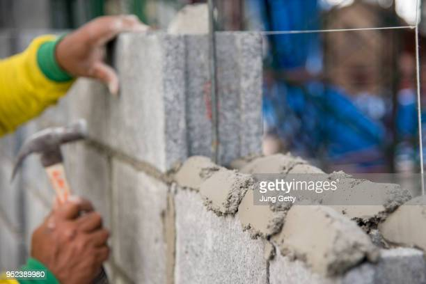 construction worker masonry work - rebuilding stock pictures, royalty-free photos & images