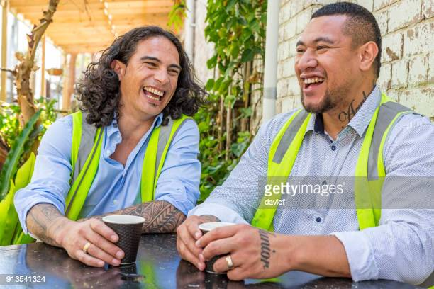 construction worker men in high vis vests having a coffee break - minority groups stock pictures, royalty-free photos & images