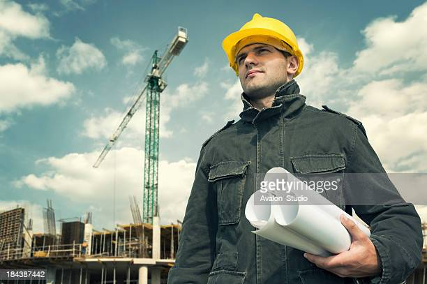 Construction worker on a construction site with plans