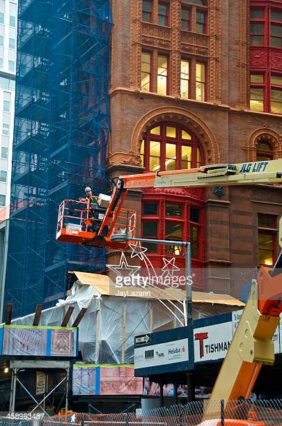 construction worker on a lift platform, lower manhattan, nyc - construction platform stock photos and pictures