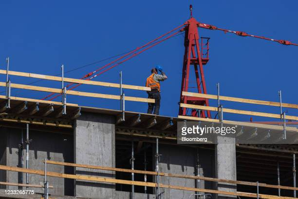 Construction worker on a residential apartment construction site, on a plot of brownfield land in the Vysoany district in Prague, Czech Republic, on...