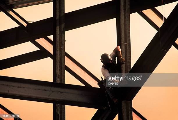construction worker on high rise frame of building - high up stock photos and pictures