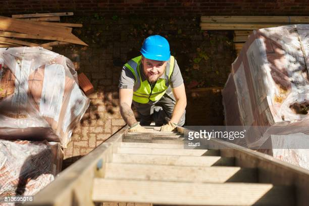 construction worker on ladder - ladder stock pictures, royalty-free photos & images
