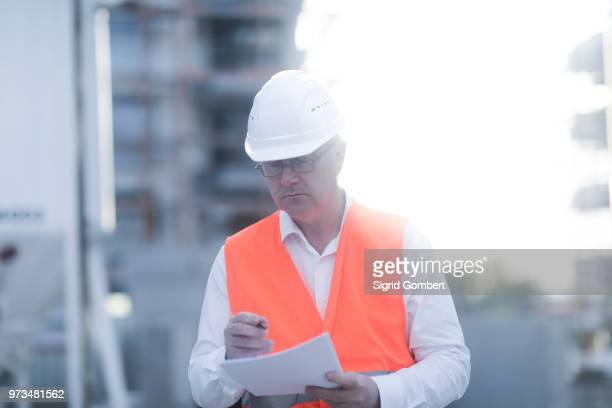 construction worker on site - sigrid gombert stock pictures, royalty-free photos & images