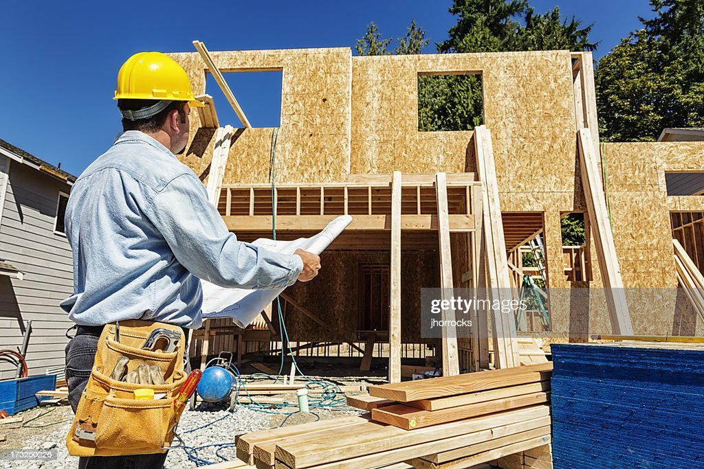 Construction Worker on Site with Plans : Stock Photo