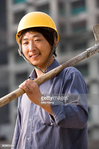 Construction worker outdoors with helmet smiling