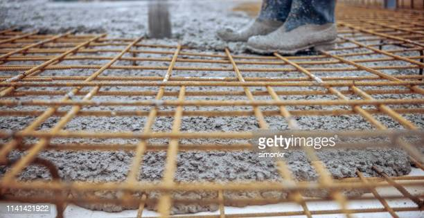 construction worker pouring cement on roof - black boot stock pictures, royalty-free photos & images
