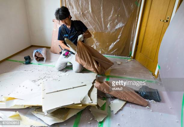 Construction worker remodeling home