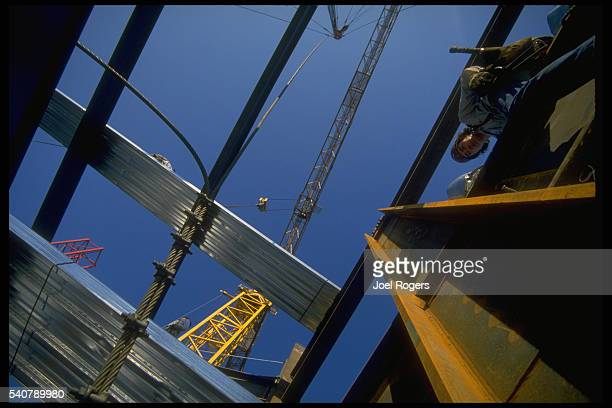 A construction worker rests on a beam of a skyscraper construction Seattle Washington USA