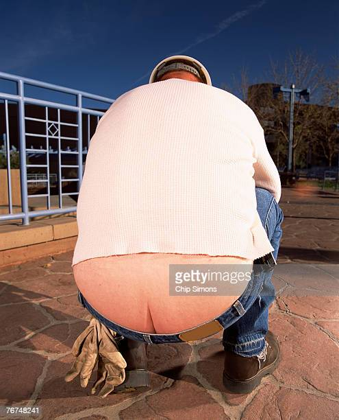 construction worker revealing butt crack - man bending over from behind stock photos and pictures