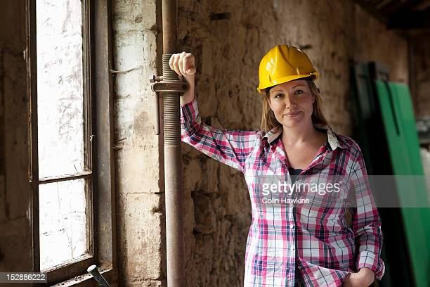 construction worker smiling on site - colin hawkins stock pictures, royalty-free photos & images