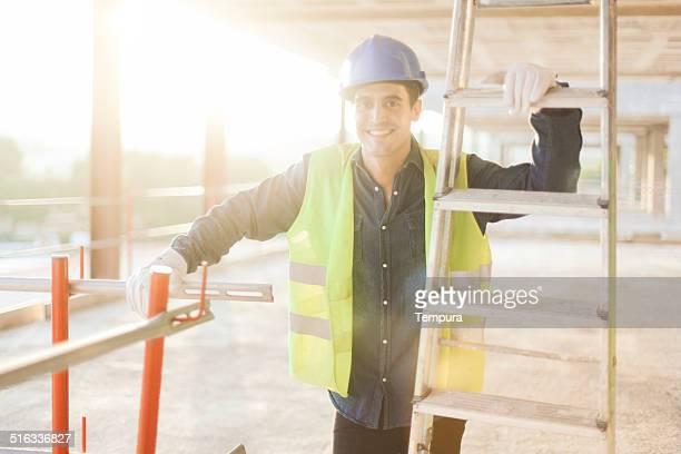Construction worker smiling  portrait.