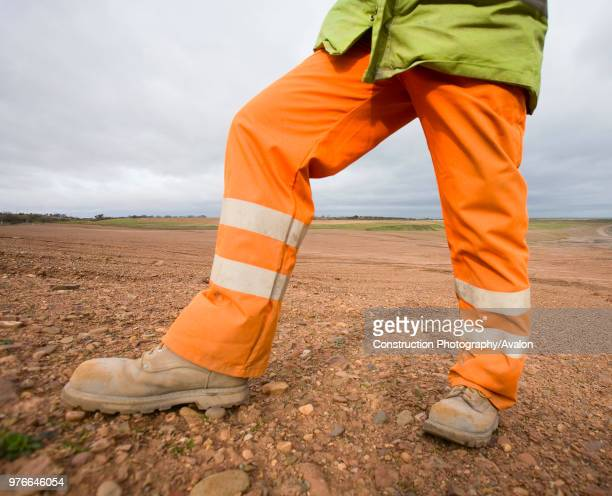 Construction worker standing on brownfield site UK