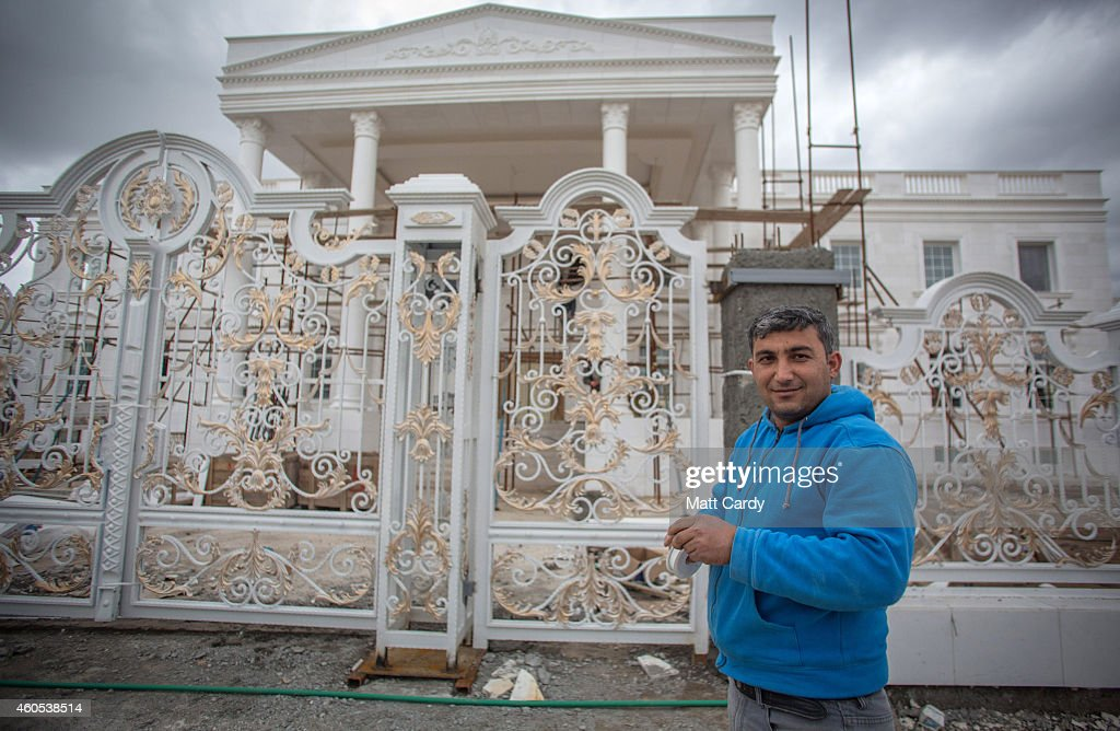 A construction worker stands outside a replica White House, a $20million villa being built inside Dream City, a new exclusive residential suburb that is being developed in Erbil on December 15, 2014 in Erbil, Iraq. Dream City, is one of several high value residential areas that have been built in the Kurdistan capital since 2003 and are complete with their own mosque, shopping areas and schools. Property values vary, but many villas in the gated and walled development are now valued at over $1million and it even features a $20million US White House replica. Despite insecurity in the rest of Iraq, the semi autonomous region of Kurdistan has been seen by some investors as the new Dubai and although the advance of Islamic State and a budget row with Baghdad has dampened some of the enthusiasm, the city skyline is still changing at a rapid pace.