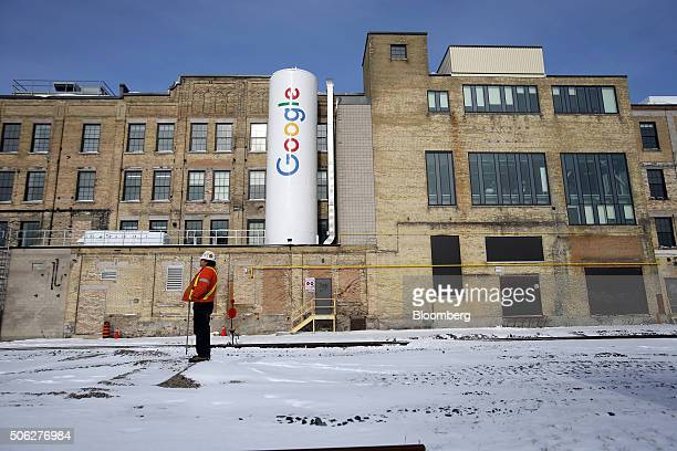 A construction worker stands outside Google Canada's engineering headquarters in Waterloo Ontario Canada on Friday Jan 22 2016 The 185000squarefoot...