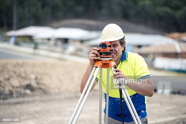 Construction worker surveying