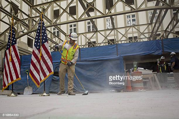 A construction worker sweeps away dust prior to an event for Donald Trump president and chief executive of Trump Organization Inc and 2016 Republican...