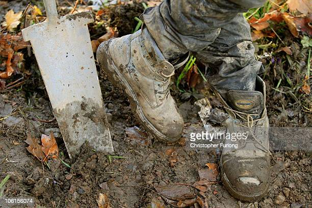 A construction worker takes a break from digging a trench on a construction site of an office buillding on October 27 2010 in Manchester England A...
