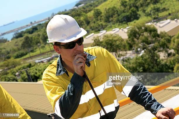 Construction Worker talking on walkie-talkie