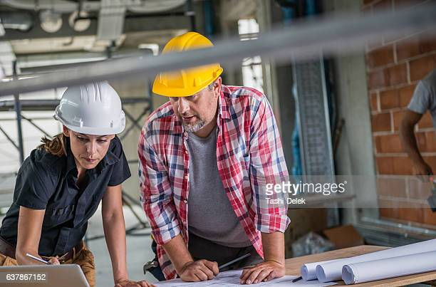 Construction Worker Talking To The Architect