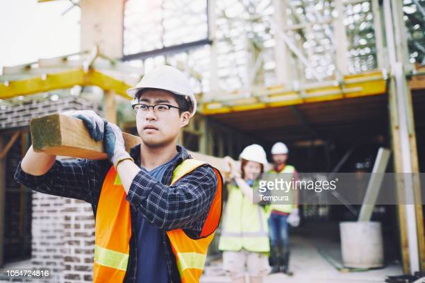construction worker team portrait looking at camera. - construction worker stock pictures, royalty-free photos & images