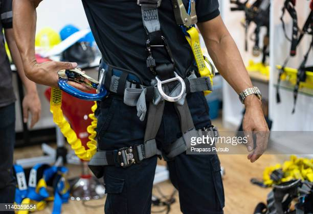 construction worker use safety harness and safety line working on a new construction site project.harness is a equipment for safety in construction - ベルト ストックフォトと画像