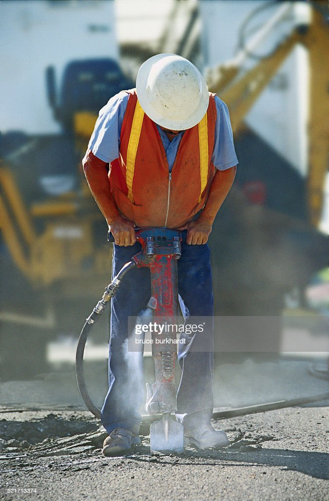 Construction Worker Using a Jackhammer : Stock Photo